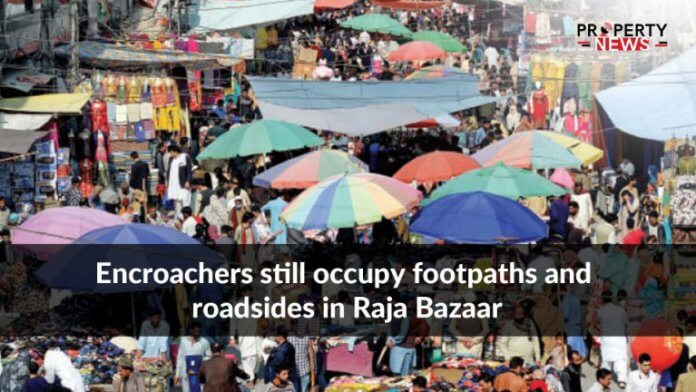 Encroachers still occupy footpaths and roadsides in Raja Bazaar